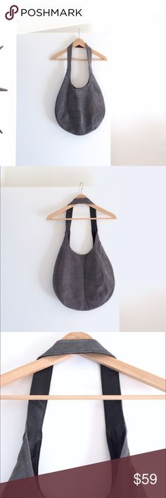 """Lands' End Suede & Leather Hobo Style Purse This luxuriously soft, gorgeous gray suede shoulder bag by Lands' End has smooth black leather inside the shoulder strap for a stylishly comfortable fit, 1 interior zipper pocket, 2 open interior pockets and a hidden magnetic closure inside the top of the bag.  Bag measures 13"""" high x 15.5"""" wide when laying flat.  Strap measures 13"""" from top of strap down to the top of bag when laying flat. Bag opening is 9"""" across. Like New, excellent condition…"""