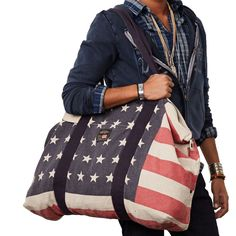 Perfect for a weekend getaway, this canvas carryall bag features an allover faded historical American flag pattern.