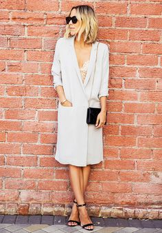Jacey Duprie of Damsel in Dior in a blazer dress, lace bra, and heels