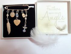 """Feathers Appear when Angels are Near Remembrance Sympathy Keepsake Gift Angel Crystal Heart Real Feather """"A Piece of my Heart is in Heaven"""" by JanbroCharmingGifts on Etsy Heart Real, Remembrance Gifts, Memorial Gifts, White Gift Boxes, Organza Gift Bags, Piece Of Me, Swarovski Pearls, Novelty Gifts, Heart Shapes"""