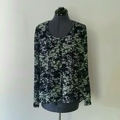 """NWOT Calvin Klein abstract pattern top Pleated detail front and back center. 100% polyester exterior.  Cotton blend interior. Five buttons down front. Spare button included. Rounded v-neckline. Loose fitting. Sleeves can be worn at full length or buttoned to 3/4.  Length 28"""" Bust 21"""" Calvin Klein Tops Blouses"""