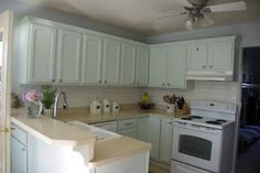 Kitchen redo with how to update a kitchen and detailed tour. This light green kitchen has the elements of a coastal kitchen with a country feel.  To see more click on post or visit http://ourhousenowahome.com/