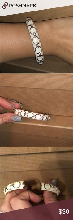 Beautiful white and gold Bangle Beautiful Bangle that's white with gold accents. Also has clear crystals throughout too. You can either slip this over your hand to put this beauty on or use the spring to pull apart and slid on over wrist.  Super fashionable and comfortable. One size fits most. I purchased this was Nordstroms and the brand is sequin. Sequin Jewelry Bracelets