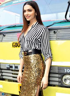 Deepika Padukone in a golden shimmer skit and black & white shirt.