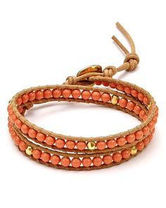 "An orange string of aventurine beads lends a pop of color to this double-wrap bracelet from Chan Luu. | Imported | 12""L with 2"" extension 