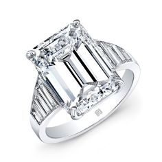 Emerald Cut Diamond Ring - Emerald Cut Diamond Ring with trapezoid cut diamonds on the band set in Platinum.