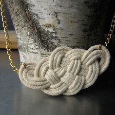 Cute rope art necklace that I could probably figure out how to re-create. I want to make a whole bunch of knotted accessories and belts for next fall. Guess I need to get a sailing manual!