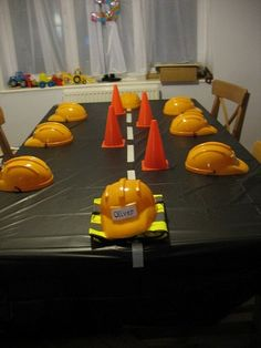 digger party - plastic hats for the children, black table cloth with masking tape to make a road. I like this for boys party. Digger Birthday Parties, Digger Party, Construction Birthday Parties, Construction Party, Birthday Party Themes, Birthday Banners, Birthday Invitations, Birthday Ideas, Hungry Caterpillar Party