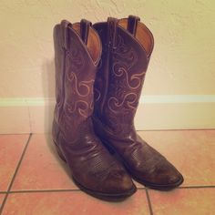 Brown & Yellow Cowgirl Boots Beautiful Tony Lama Boots. Women's size 9. Beautiful dark brown with deep yellow embroidery. Bought these to wear on my wedding day. Love them but need to make room for a baby. Offers welcome Tony Lama Shoes Heeled Boots