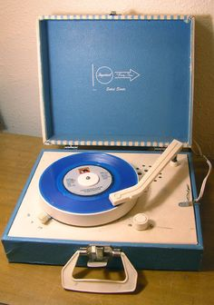 My little portable record player-- I would spend hours listening to Disney Read-Along records with this! SEE the pictures, HEAR the words, READ the book!