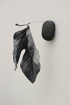 Emily DuBois. Fig leaf and stone.  Cotton thread, stone, wire, swivel.  12 x 8 x 5 inches.  Fiber Philadelphia 2012.
