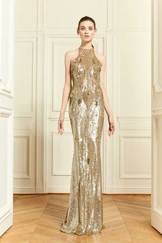 This Zuhair Murad dress sparkles and shines! It reminds me of an Oscar! It is very glamorous