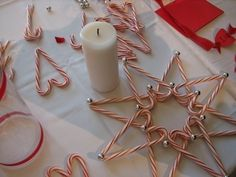 Candy Cane & Candle Centerpiece  Here's a project idea for a centerpiece using a holiday favorite, candy canes. by Karrakolan