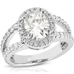 Oval Split Shank Halo Engagement Ring....Gorgeous! But I want a circle instead of an oval ;-)