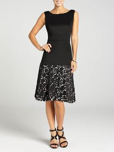 Laura. Sleeveless. Laser cut skirt. Waist inset. Fit-and-flare. Back zip with hook