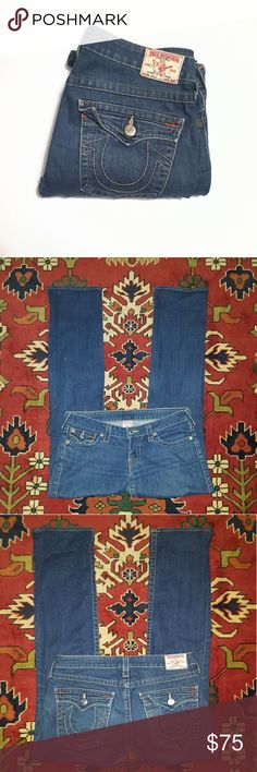 """True Religion Billy Jeans Size 31 x 33 Great pair of authentic True Religion jeans! Very good overall condition. I took pics with and without flash. Distressed and straight leg.  🌻There is some wear/fading in addition to the company distressing, look at the 6th pic collage. There are a few light """"dots"""" on the legs that are small marks of wear, there is pilling on inner pockets, wear on crotch area (no holes or thinning of fabric)🌻  99% cotton, 1% spandex.  Waist approx 14"""" across when…"""
