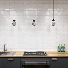 Bespoke kitchen in an old blacksmiths workshop by Studio MacLean. Earls Court. London. #interiordesign #kitchens #bespokekitchen #studiomaclean #lighting #cagedlights #metrotiles #formica #plywood Photography by @christubbsphotography_projects by studiomaclean