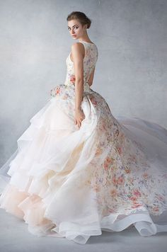 Sherbet silk organza floral printed bridal ball gown, jewel neckline front and back, dropped waist, side gathered pickup skirt layered with horsehair trimmed tulle, chapel train. Lazaro, Spring 2016