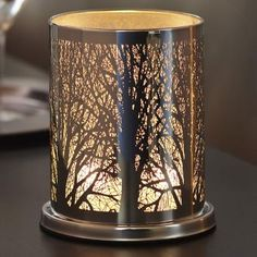 An intricate maze of photo-etched branches creates the aura of an enchanted forest. Metal hurricane with glass cup for votives or tealight candles. SHOP ONLINE at http://www.partylite.biz/legacy/sites/nikkihendrix/productcatalog?page=productdetail&sku=P90931&categoryId=58057&showCrumbs=true