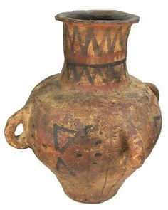 "Terracotta amphora with four handles and painted red and black geometric designs around the body and the neck. Flattened bottom, stands by itself. Israelite. Earthen patina. 1200 - 1000 BC  (16"" x 13 1/2"")"