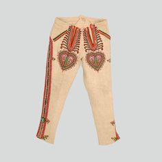 Portki trousers made of homespun wool. Flies decorated with heart-shaped parzenica pattern. Side stripes: wool appliqués and embroidery. Cuts fastened with hooks and eyes in the lower part of the leg. Hand sewn.  Łącko Highlanders, Zabrzeż, P. Nowy Sącz, ca. 1900-1935