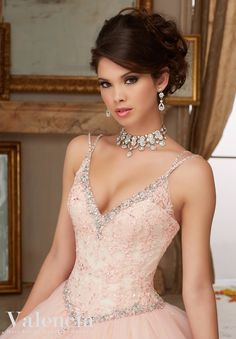 Beaded Lace Bodice on Princess Tulle Ball Gown Quinceanera Dress Designed by Madeline Gardner. Matching Bolero Jacket.