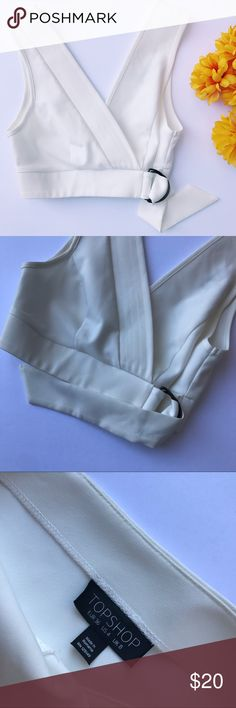 """Topshop Crop Top Faux wrap style topshop crop top! Super adorable with a pair of high waisted jeans. Band across 13"""". Length 14"""". Excellent used condition. No stains or holes.  ::14 Topshop Tops Crop Tops"""