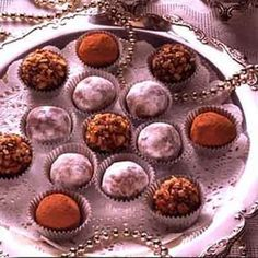 These rich chocolate truffles are pure indulgence. Christmas Truffles, Christmas Treats, Christmas Baking, Christmas Stuff, Chocolate Truffles, Melting Chocolate, Chocolate Recipes, Holiday Snacks, Holiday Recipes