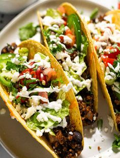 """These vegetarian black bean tacos are a touch taco spice blend to get a badly yummy""""meaty"""" filling. Then they are smothered with cheddar cheese and baked-up crispy and crunchy. Mushroom Bourguignon, Bourguignon Recipe, Cooking Recipes, Healthy Recipes, Keto Recipes, Casserole Dishes, Mexican Casserole, Black Bean Tacos, Vegan Stew"""