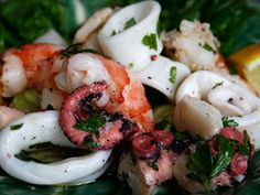 Antipasti di Mare ~ This is a wonderful Christmas Eve appetizer but is tasty year round. This seafood salad often contains octopus as well as shrimps, scallops, and calamari, but if you prefer, you can certainly leave the octopus out. The octopus requires a much longer cooking time, so if you choose to include it, you will need to add an additional hour or so to your preparation time.