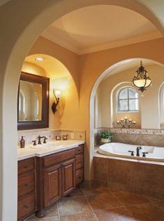Install warm wall sconces in master bathroom