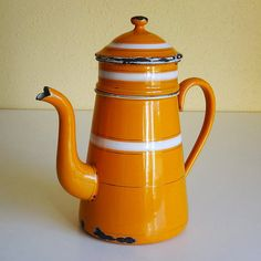 vintage French enamelware coffee biggin. Gorgeous warm orange color with thick white enamel bands and gold pin stripes. Available at AtticAntics, $95.00