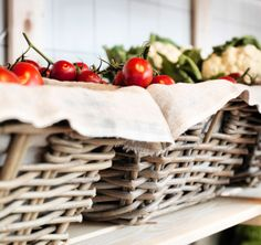 BYHOLMA rattan baskets filled with tomatoes and cauliflower
