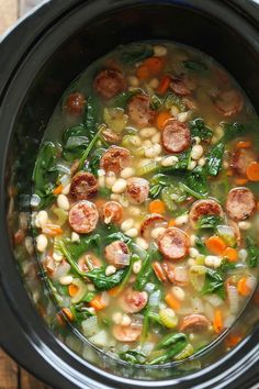 Slow Cooker Sausage, Spinach, and White Bean Soup  - Delish.com