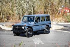 This 1981 Mercedes 230GE shows 48k miles and has four-doors, a long wheelbase, and a 5-speed. The truck is said to be mechanically unmodified and has been repainted in Mercedes Granite Grey. This G-Wagen features a plaid interior and has had some past rust repair in the rear quarters.
