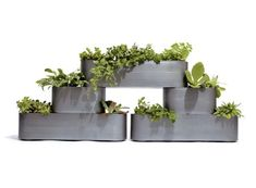 Pony Planters —stack any way you like on a patio or terrace. ACCESSORIES -- Better Living Through Design