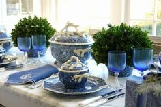 Blue-tinted glassware draws the eye toward these cute mini topiaries.  See more from Carolyne Roehm »