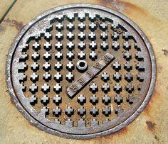 The Mathematical Tourist: Manhole Cover Geometry