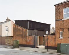 Russell Jones has designed Windsor Road, a house in Tottenham clad in corrugated cellulose sheets, peeking up from behind a former Victorian outbuilding. Architecture Today, Architecture Magazines, Contemporary Architecture, British Architecture, Windsor, Russell Jones, Black Cladding, Metal Cladding, Builders Merchants