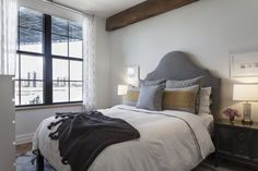 Sheena's Unbelievable View in Dumbo— featuring Upholstered Headboard + Chunky Tassel Throw + Ikat Links Rug from west elm