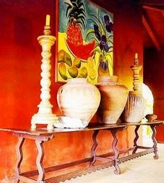 .Bright Hacienda wall colors..orange, red and yellows..great pottery and art