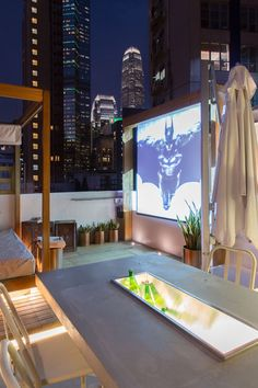 Make your rooftop a resident favorite with a movie screen. Perfect for summer viewing parties.