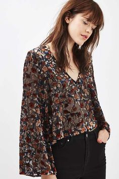 black v neck top with floral print and drapey sleeves