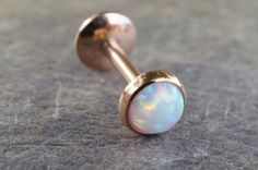 White fire opal 16 gauge rose gold cartilage earring, monroe, tragus or helix piercing. 316L surgical steel plated rose gold barbell piercing is 16