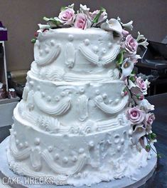 """The longer you look at this, the funnier it gets. Seriously. Can we take a moment to """"appreciate"""" those bottom borders? And the fact that the baker used the giant shell tip to do all the delicate piping work? Huh? Can we? ~ Jen Yates"""