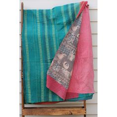 "The quilts are usually comprised of between 2-5 layers of saris. Its size can range from 50-55"" x 70-80"". To make their throw, each woman carefully selects her thread color and will often add decorative patches to the blankets. Cotton."