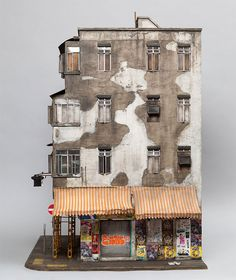 Immensely detailed, phenomenally imagined and compellingly designed sculptures of urban buildings by artist Joshua Smith. Most of the pieces are inspired by the famed Kowloon City and feature posters, trash, leaves and everything else down to the last detail.   More info: Joshua Smith (h/t: supers