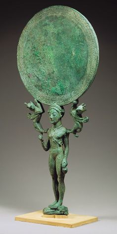 """mini-girlz:  """" Bronze mirror with a support in the form of a nude girl  Period: Archaic  Date: 2nd half of the 6th century B.C.  Culture: Greek, Laconian  Medium: Bronze  Dimensions: H. 13 5/16 in. (33.8..."""