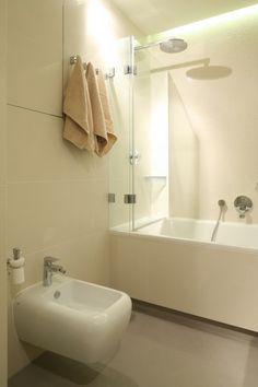 Mała łazienka: tak połączysz wannę i prysznic - zdjęcie numer 3