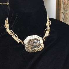 """Beautiful caged stone necklace NWOT Stringed stones weaved through a linked chain. Stone has a imperfection on back side as pictured.  Not noticeable when wearing. Measures 16"""" with a  2.5"""" adjustable claw clasp closure. Jewelry Necklaces"""